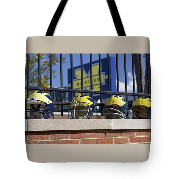 Wolverine Helmets Of Different Eras On Stadium Wall Tote Bag