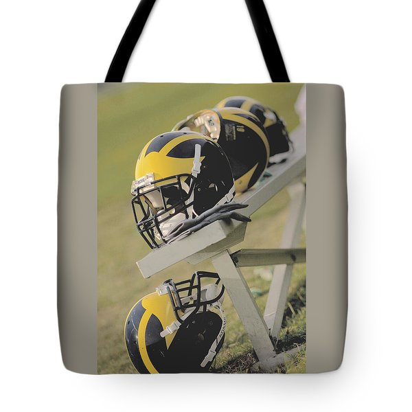 Wolverine Helmets On A Football Bench Tote Bag