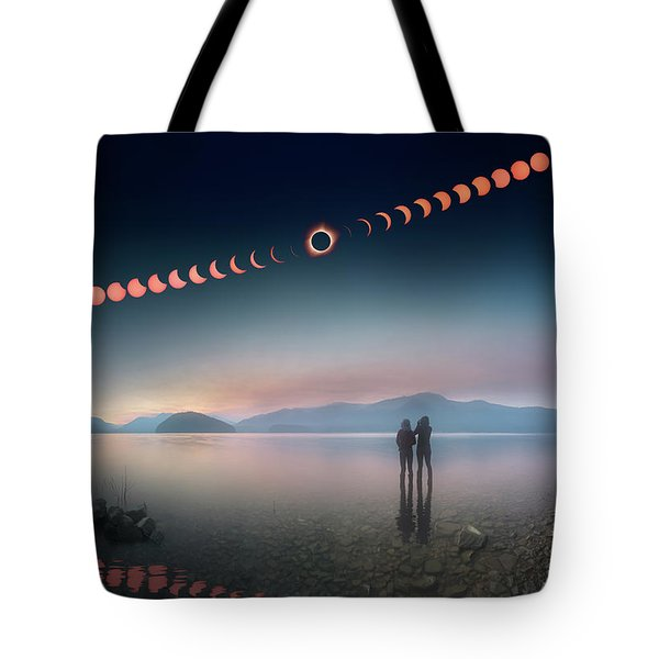 Tote Bag featuring the photograph Woman And Girl Standing In Lake Watching Solar Eclipse by William Lee