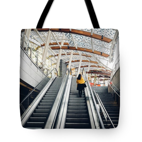 Woman Going Up Escalator In Milan, Italy Tote Bag