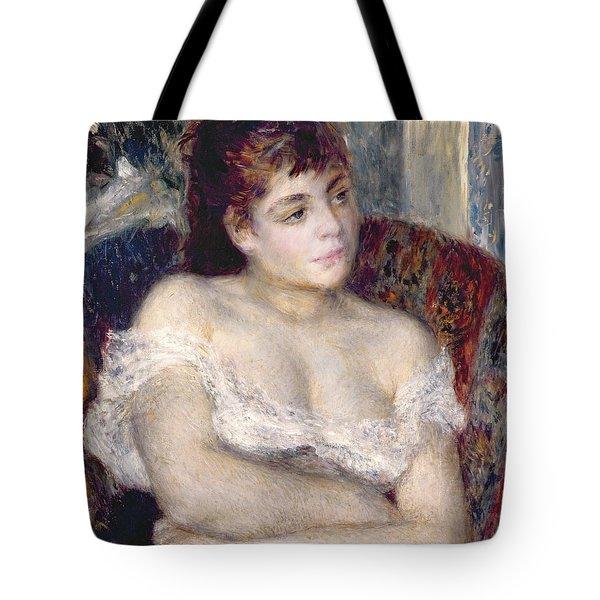 Woman In An Armchair Tote Bag by Pierre Auguste Renoir