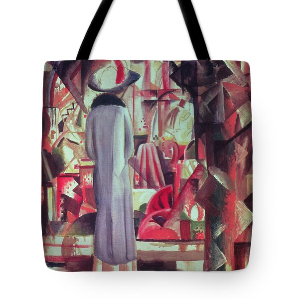 Woman In Front Of A Large Illuminated Window Tote Bag
