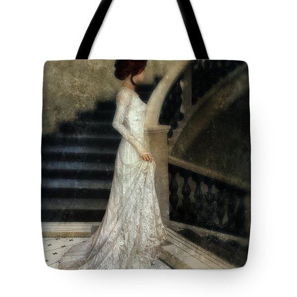 Woman In Lace Gown On Staircase Tote Bag by Jill Battaglia