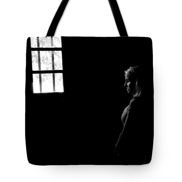 Woman In The Dark Room Tote Bag