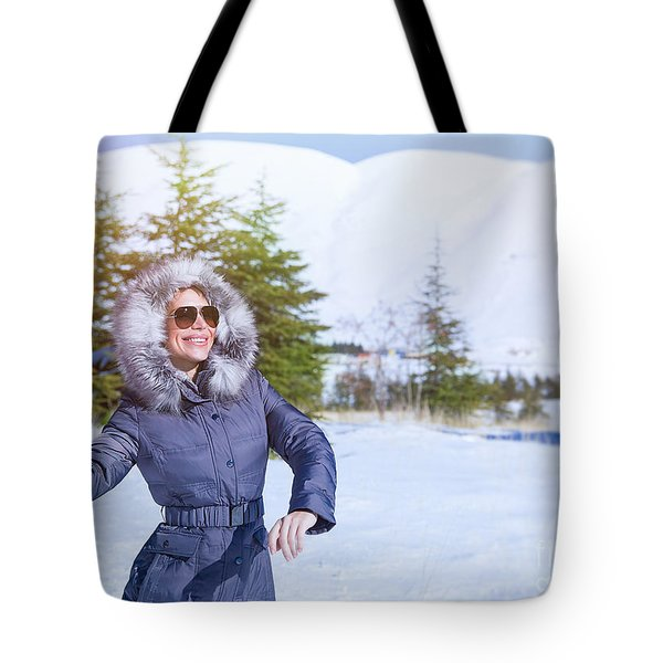 Woman Playing In Winter Park Tote Bag