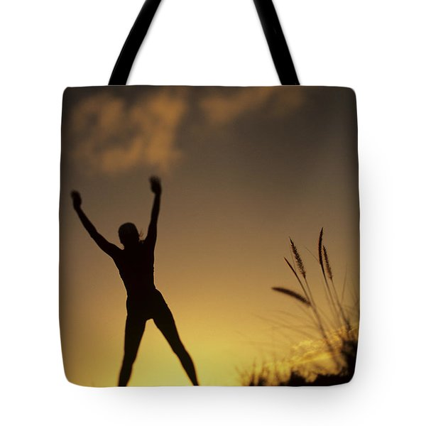 Woman Stretching On A Mountain Tote Bag by Dana Edmunds - Printscapes
