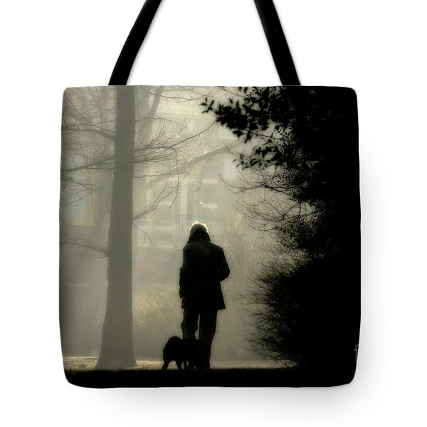 Tote Bag featuring the photograph Woman Walking Dog by Patricia Hofmeester
