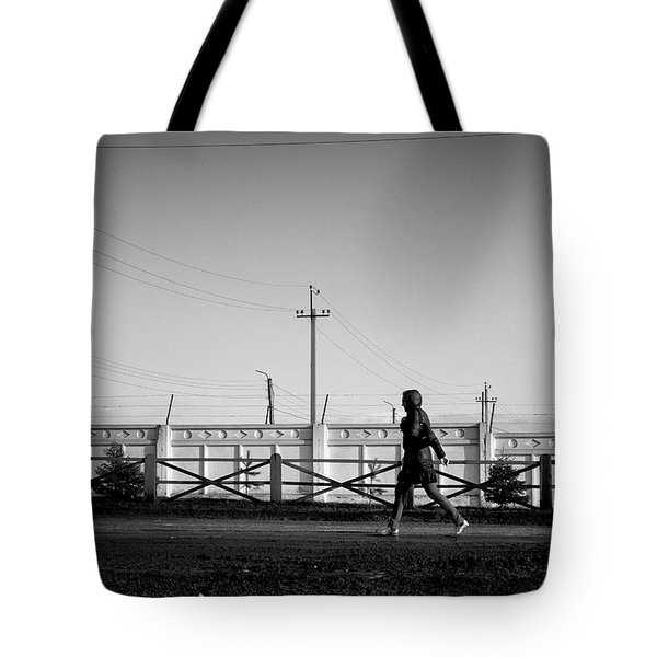 Tote Bag featuring the photograph Woman Walking In Industry by John Williams
