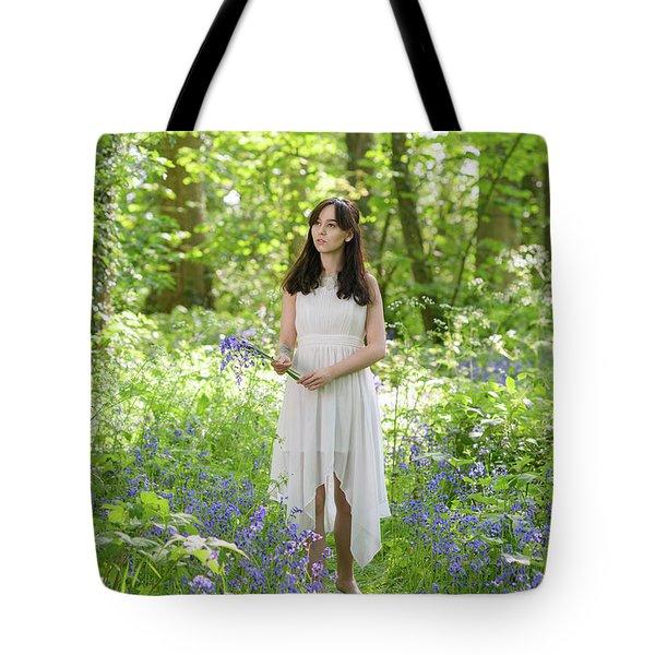 Woman Walking Through Bluebells Tote Bag