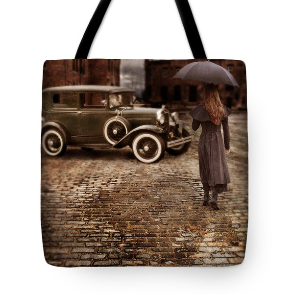 Woman With Umbrella By Vintage Car Tote Bag by Jill Battaglia