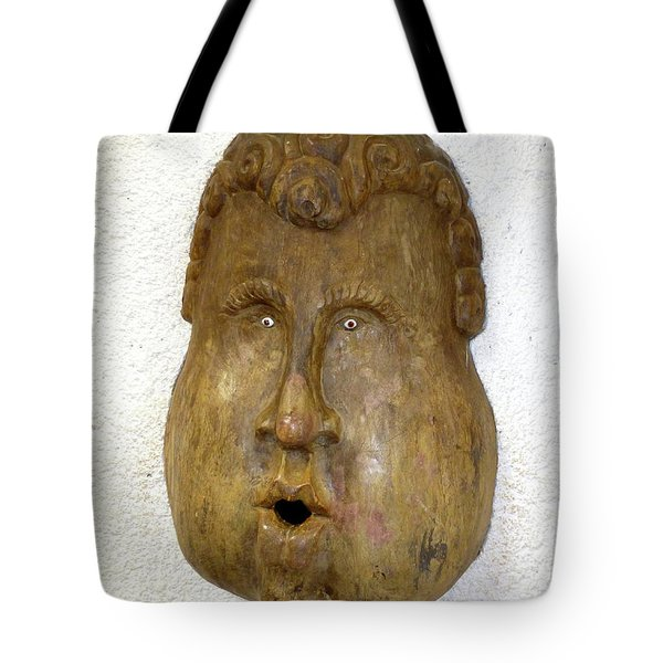 Tote Bag featuring the photograph Wood Carved Face by Francesca Mackenney