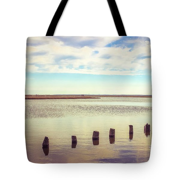 Tote Bag featuring the photograph Wood Pilings In Still Water by Colleen Kammerer