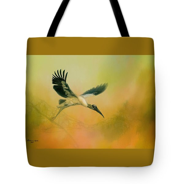 Tote Bag featuring the photograph Wood Stork Encounter by Marvin Spates