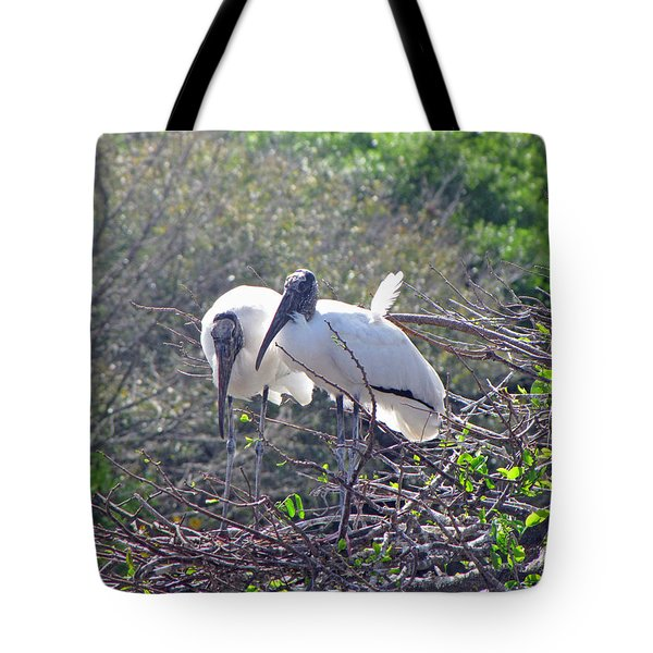 Tote Bag featuring the photograph Wood Storks by Martha Ayotte