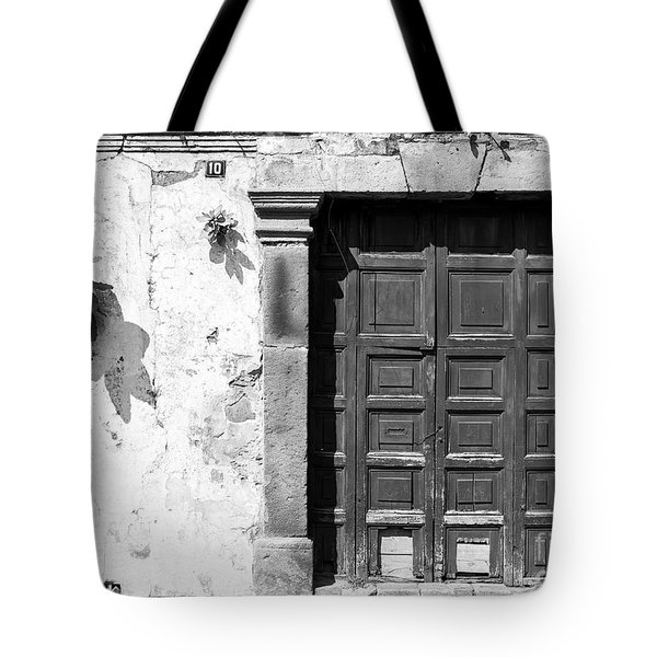 Tote Bag featuring the photograph Wooden Door Antigua Guatemala Black And White by Tim Hester