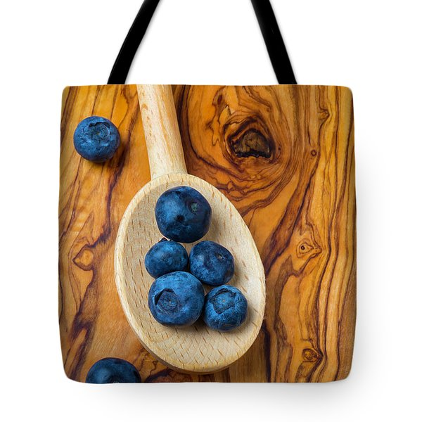 Wooden Spoon And Blueberries Tote Bag by Garry Gay