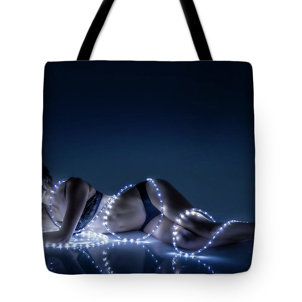 Tote Bag featuring the photograph Wrapped In Light by Rikk Flohr