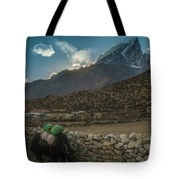 Tote Bag featuring the photograph Yaks Moving Through Dingboche by Mike Reid