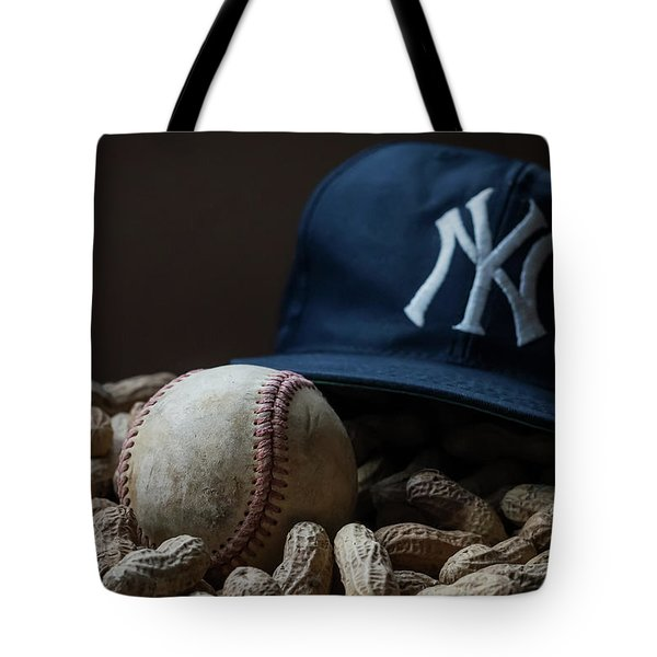 Tote Bag featuring the photograph Yankee Cap Baseball And Peanuts by Terry DeLuco