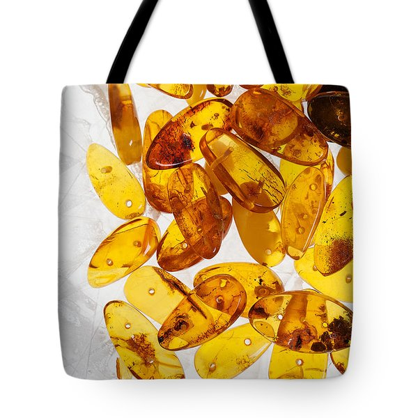 Tote Bag featuring the photograph Yellow Amber Stones  by Andrey  Godyaykin
