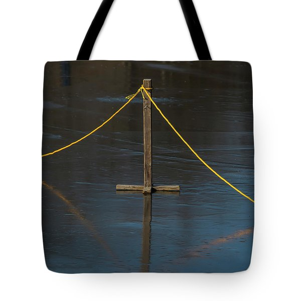 Tote Bag featuring the photograph Yellow Boundary On Ice by Gary Slawsky
