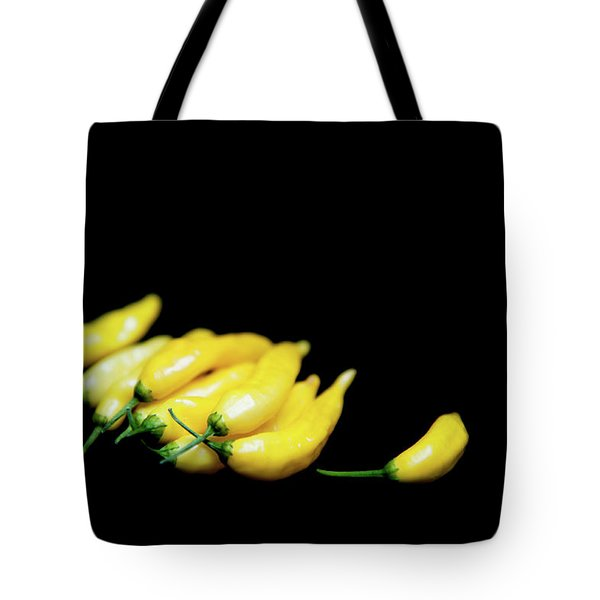 Yellow Chillies On A Black Background Tote Bag