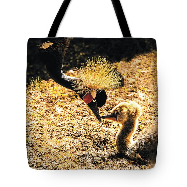 Yellow Crowned Crane Feeding Her Chick Tote Bag