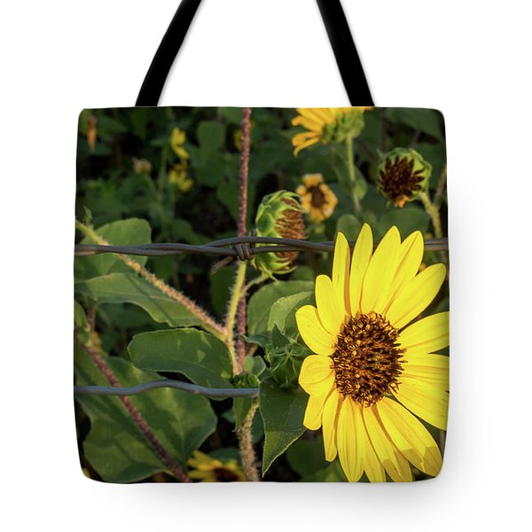 Yellow Flower Escaping From A Barb Wire Fence Tote Bag