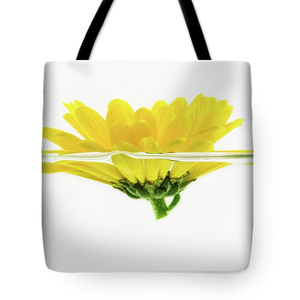 Yellow Flower Floating In Water Tote Bag