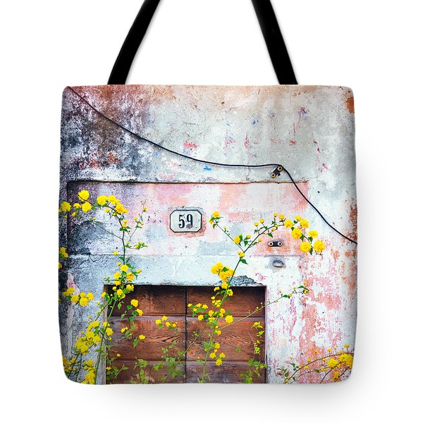 Yellow Flowers And Decayed Wall Tote Bag