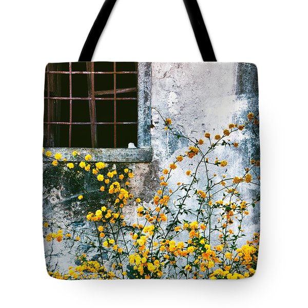 Tote Bag featuring the photograph Yellow Flowers And Window by Silvia Ganora