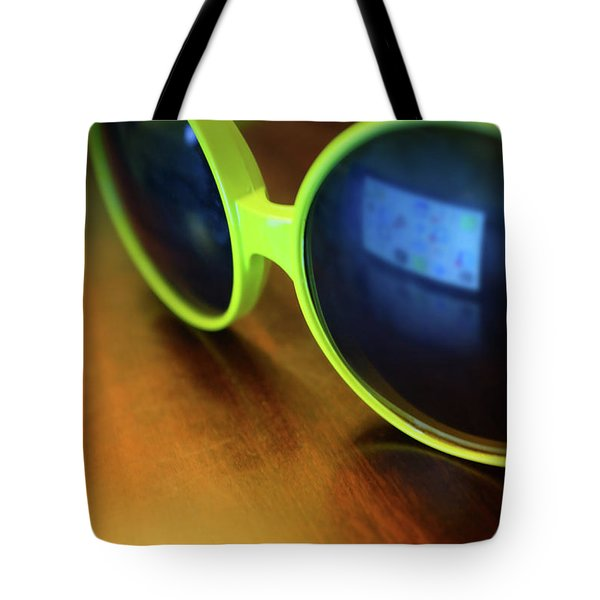 Tote Bag featuring the photograph Yellow Goggles With Reflection by Carlos Caetano
