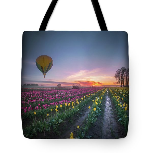 Tote Bag featuring the photograph Yellow Hot Air Balloon Over Tulip Field In The Morning Tranquili by William Lee