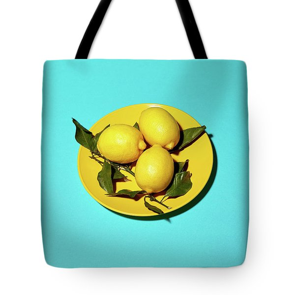 Yellow Lemons On Cyan Tote Bag by Oleg Cherneikin