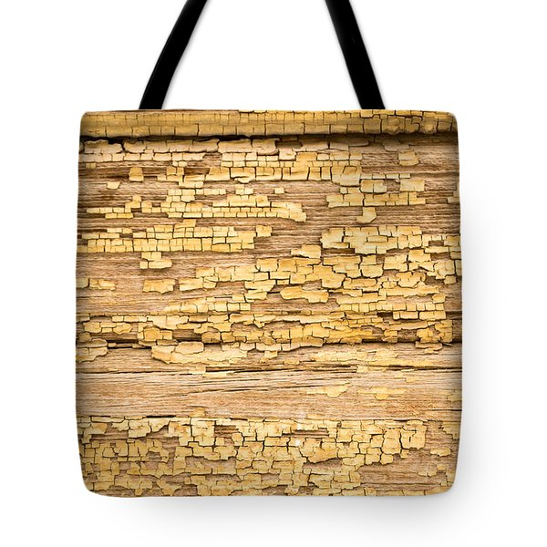 Tote Bag featuring the photograph Yellow Painted Aged Wood by John Williams
