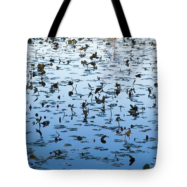 Tote Bag featuring the photograph Yellow Water Lilies In Deep Silhouette by Lon Dittrick