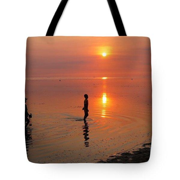 Young Fishermen At Sunset Tote Bag