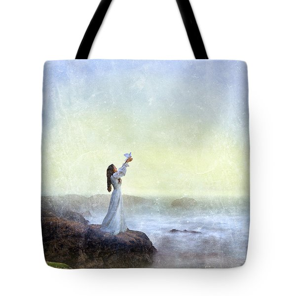 Young Lady Releasing A Dove By The Sea Tote Bag by Jill Battaglia