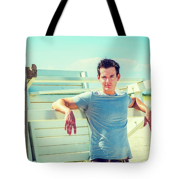 Young Man Relaxing On The Beach Tote Bag