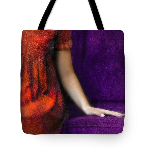 Young Woman In Red On Purple Couch Tote Bag by Jill Battaglia