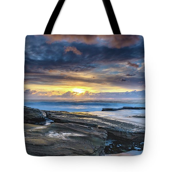 An Atmospheric Coastal Sunrise Tote Bag