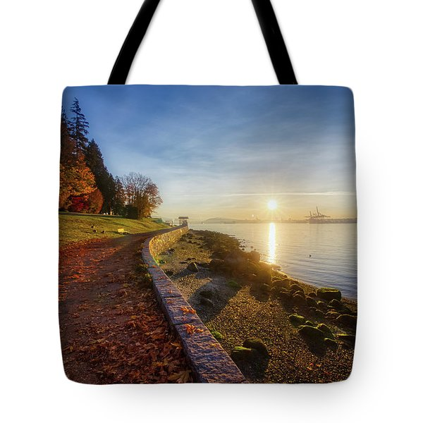 Tote Bag featuring the photograph Colorful Autumn Sunrise At Stanley Park by Andy Konieczny
