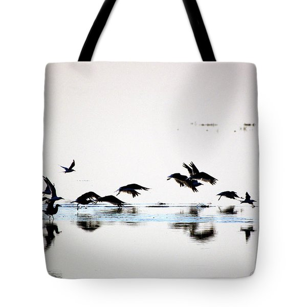 Tote Bag featuring the photograph Flight by Buddy Scott