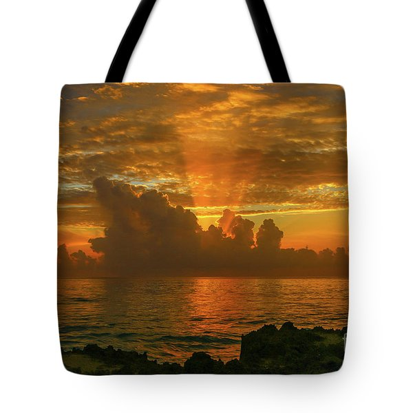Tote Bag featuring the photograph Orange Sun Rays by Tom Claud