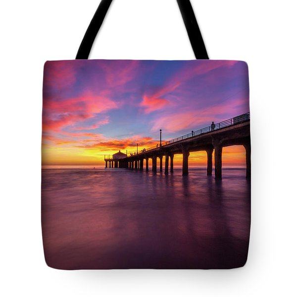 Tote Bag featuring the photograph Stunning Sunset At Manhattan Beach Pier by Andy Konieczny