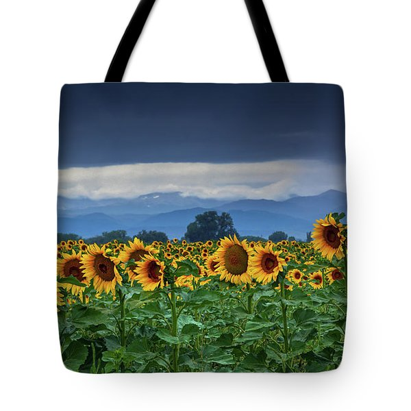 Tote Bag featuring the photograph Sunflowers Under A Stormy Sky by John De Bord