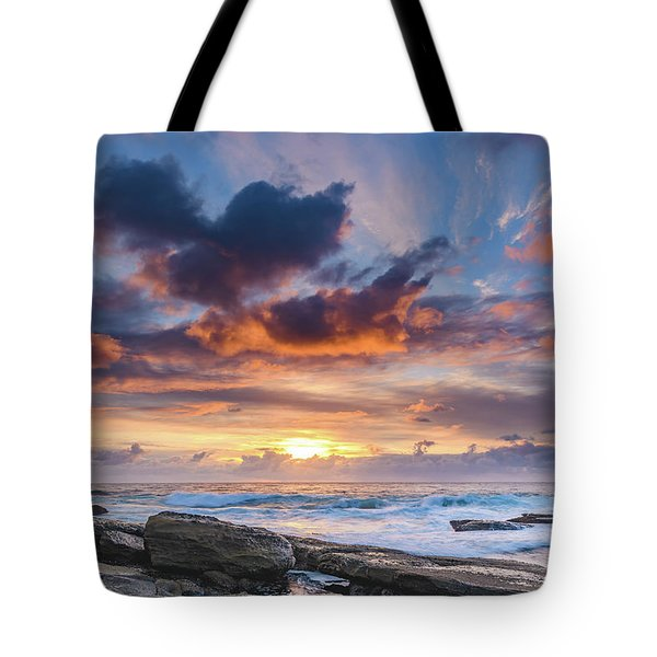 An Atmospheric Sunrise Seascape Tote Bag