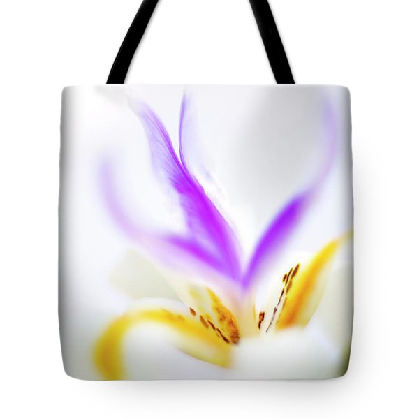 Tote Bag featuring the photograph White Iris II by John Rodrigues