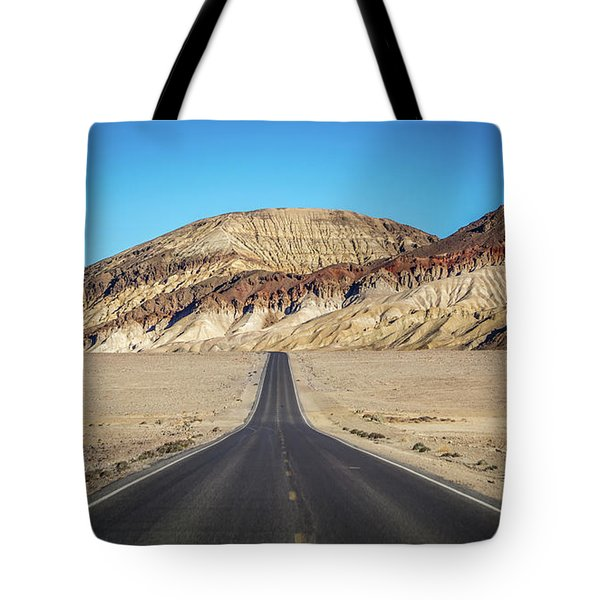 Tote Bag featuring the photograph Lonely Road In Death Valley National Park In California by Alex Grichenko