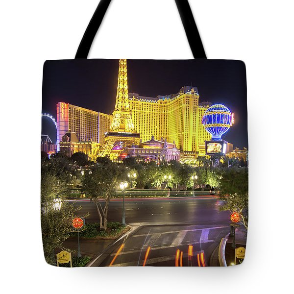Tote Bag featuring the photograph Nigh Life And City Skyline In Las Vegas Nevada by Alex Grichenko